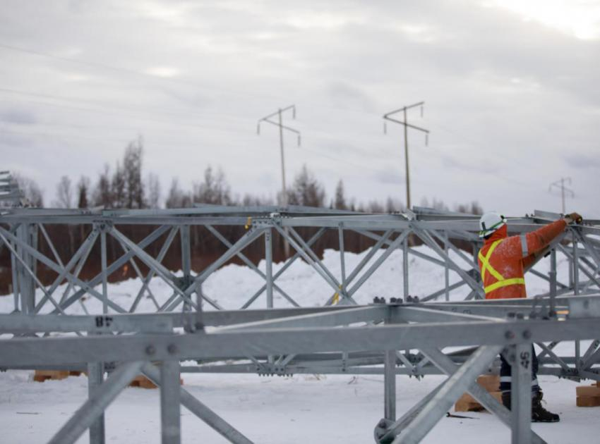 A worker assembles one of 405 towers that will hold up two new, 75-km long, 500 kV transmission lines. This will connect power from Site C substation to BC Hydro's transmission system through the Peace Canyon switchyard near Hudson's Hope. (February 2019)