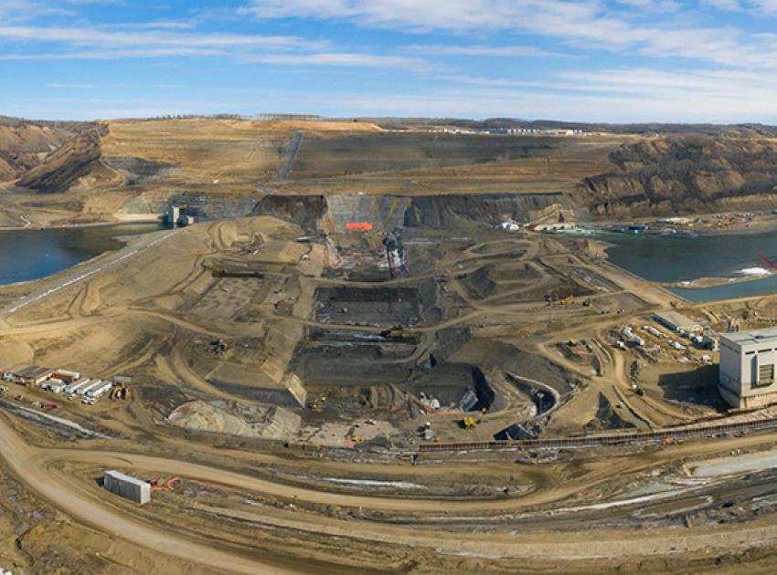 A panorama view of dam site excavations between the upstream and downstream cofferdams. Both cofferdams completely seal off the Peace River so that work on the earthfill dam can occur. (March 2021)