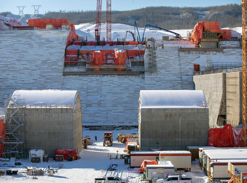 Crews pour concrete at the lower level spillway gates. The dam spillways will allow the passage of large volumes of water from the reservoir into the river channel downstream. (February 2021)