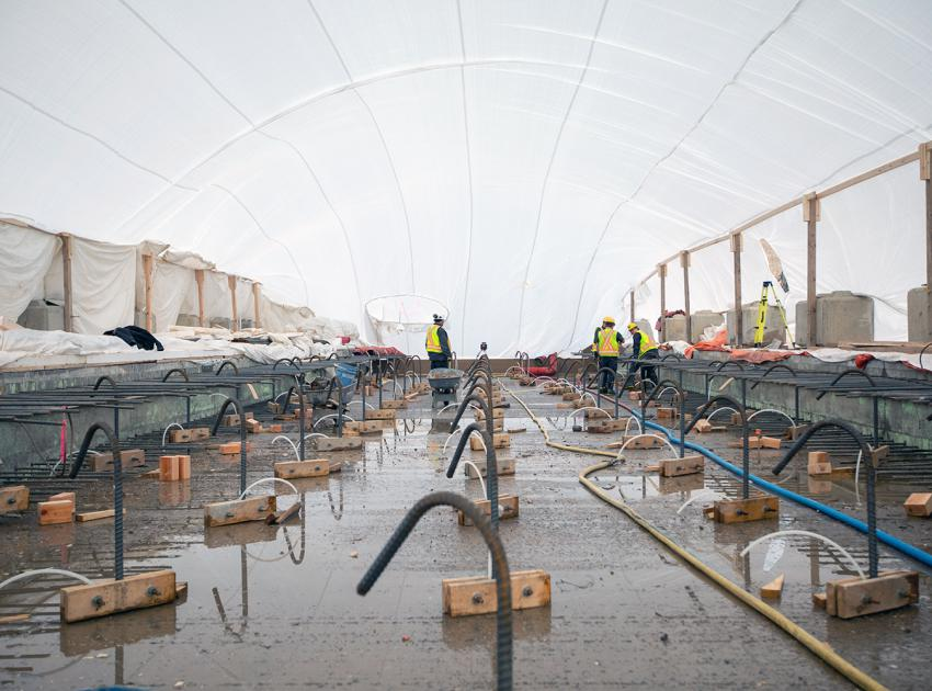 Preparing rebar dowels for grouting in the spillway stilling basin, which will anchor the slabs to the roller-compacted concrete. About 8,000 dowels will be installed at depths between 4 to 13 metres in the concrete below. (November 2019)