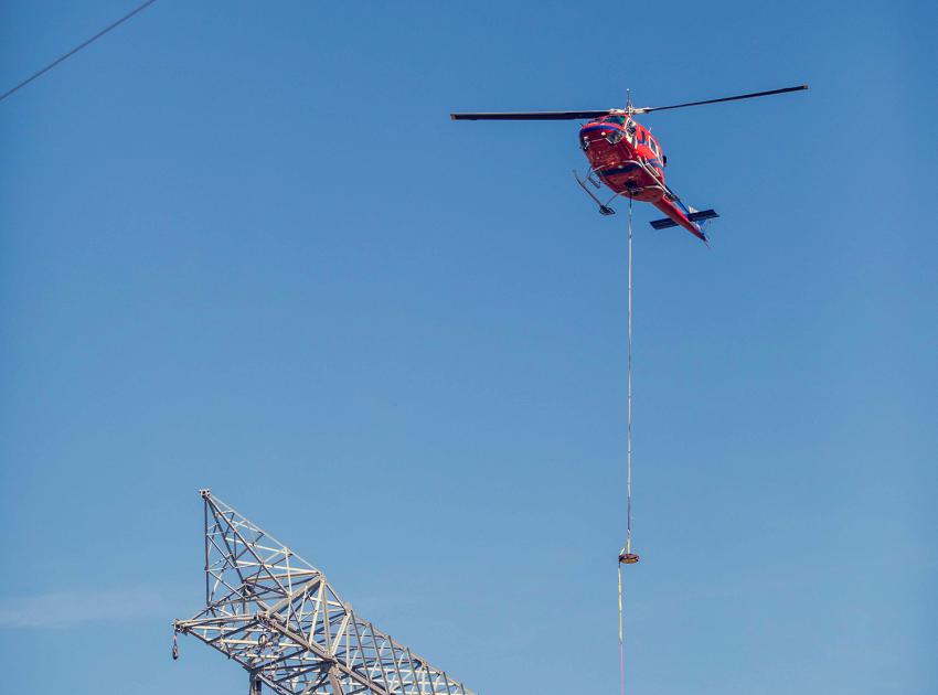 The helicopter completes the sock line installation on a free standing 500 kilovolt transmission tower near the Peace Canyon switchyard. (August 2020)