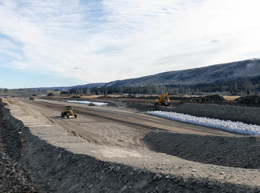 Developing an aggregate source near Lynx Creek for the Highway 29 road realignment. The white bags are filled with aggregate and stored for use as shoreline protection. (March 2020)