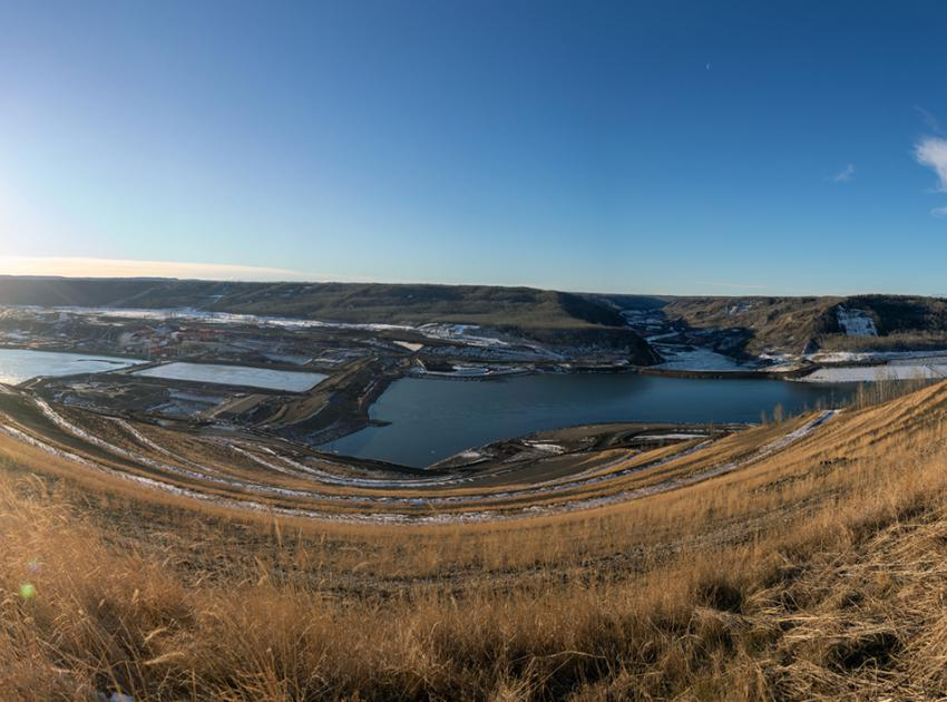An view from the Site C north bank overlooking the the downstream cofferdam (left), the upstream rockfill berm (centre-right), and head pond (right). (December 2020)