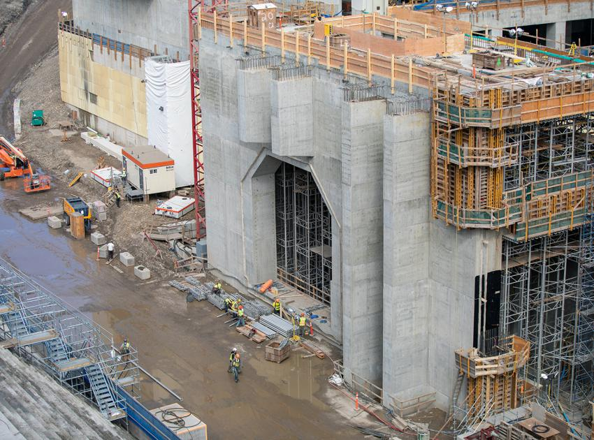 Construction of the unit 1 coupling chamber will connect the penstock to the turbine at the base of the powerhouse. (August 2019)