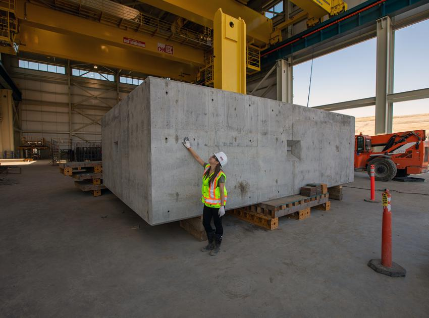 A 200-tonne concrete block is used to test the powerhouse bridge cranes before use. (September 2019)