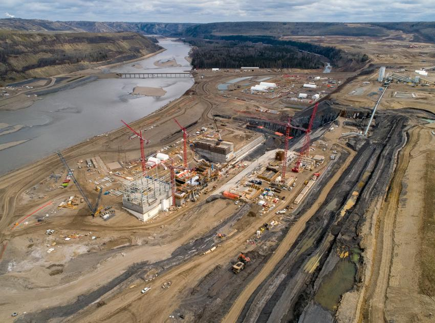 Aerial view looking over the right bank coffer dam area which include the intakes, main service bay, powerhouse, spillways and approach channel excavation work. (Spring 2019)