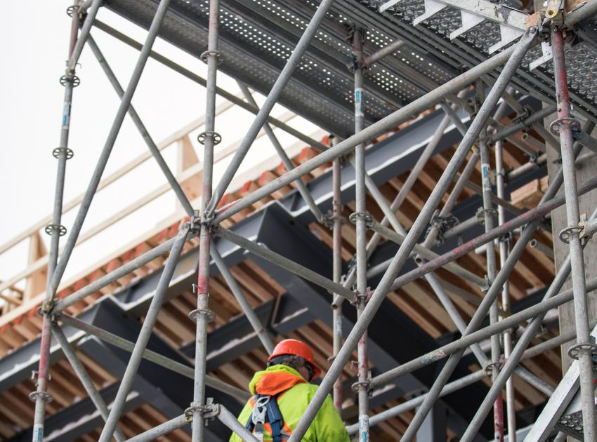 An inspector reviews and certifies that scaffolding is safe and complies with regulations.  All parts of the project are regularly monitored by environmental and safety inspectors. (January 2019)