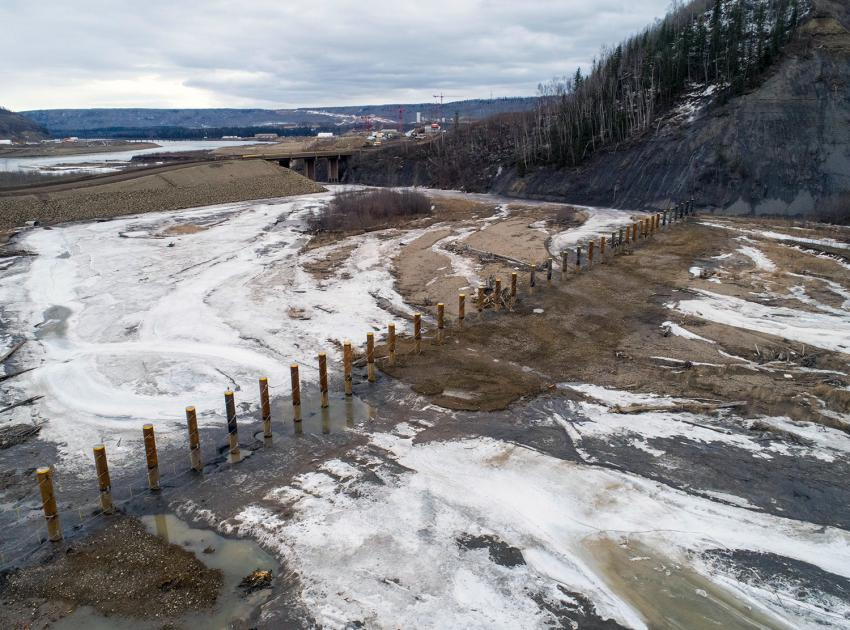 The completed piles structure, located at the mouth of the Moberly River, will capture floating debris before it reaches the dam site. (April 2020)