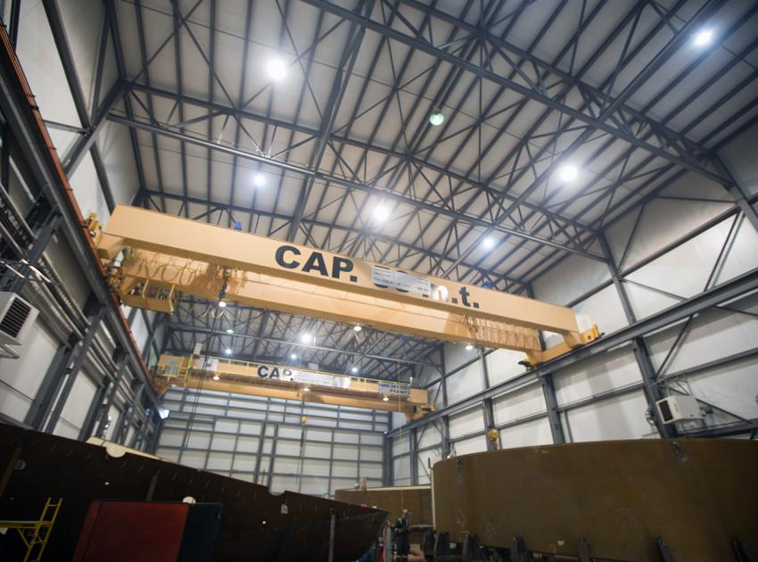 Overhead cranes in the workshop in Fort St. John where our penstock parts are assembled. Penstocks are 8-metre-wide pipes that move water from the river intakes to the turbines. (January 2019)