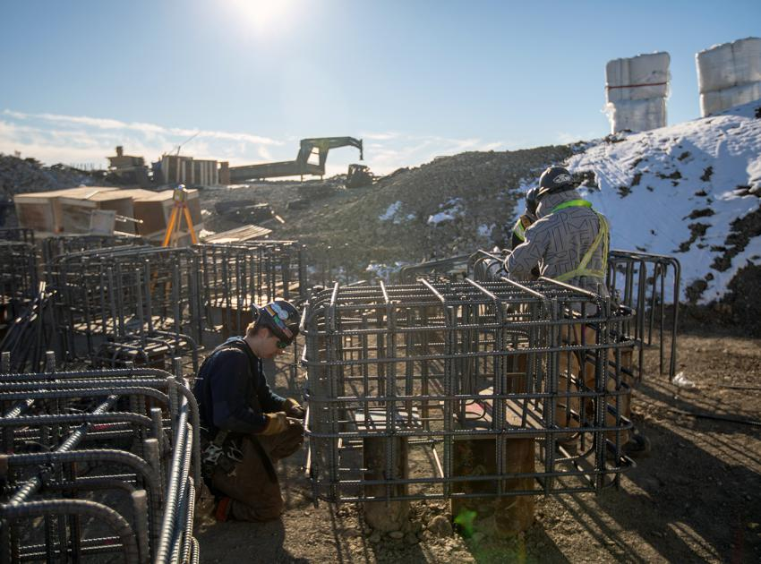 A worker installs the reinforcing bar for pile caps on the 5-kilomtetre-long conveyor belt which will move till materials to the dam site for dam construction. (Spring 2019)