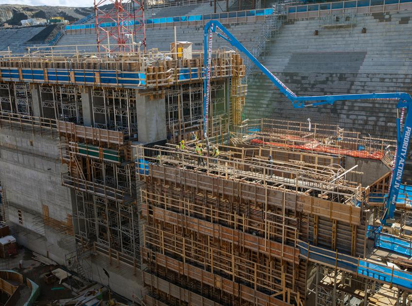 The blue arm is a concrete-placing boom used for pouring concrete into the coupling chamber of generating unit 2. (September 2019)