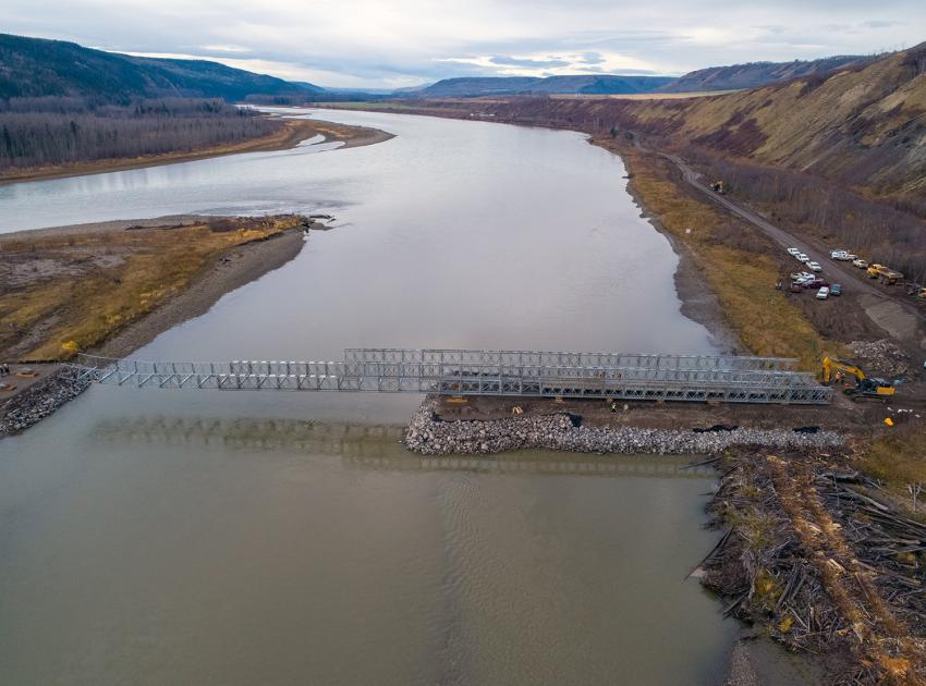 Launching of the super structure bridge off the causeway to an island, spanning the back channel of the Peace River. The bridge will be used for clearing equipment access. (October 2019)