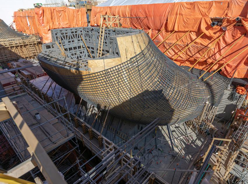 Construction of unit 2 of 6 of the draft tube elbow formwork for the Powerhouse. The draft tube recovers the surplus kinetic energy of the water as it exits through the turbine. (Spring 2019)
