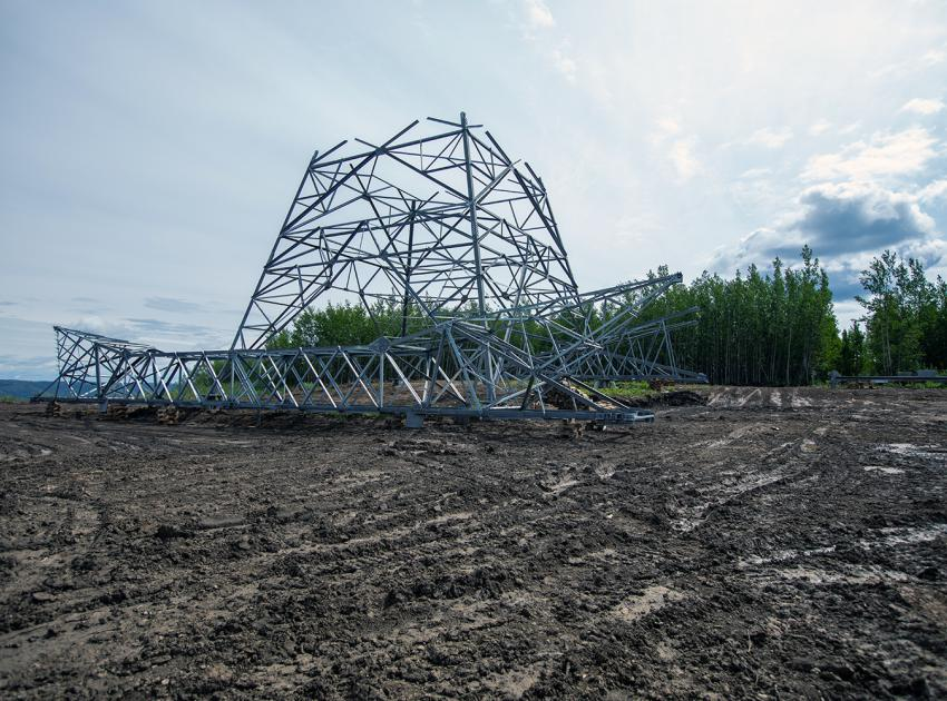 A partially assembled 500-kV transmission tower is almost ready to be installed on the transmission line corridor. (July 2019)