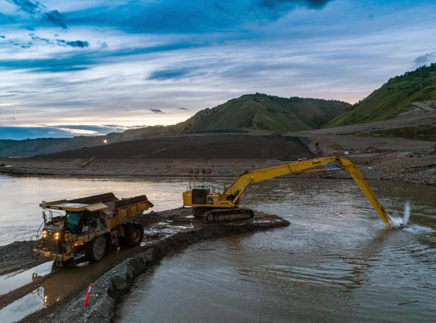 A specialized excavator dredges and deepens the approach channel to the diversion tunnels. (August 2020)