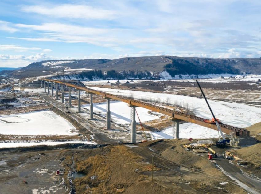 Crews completed installing the steel bridge girders – the main horizontal support beams – across the Halfway River bridge. (March 2021)